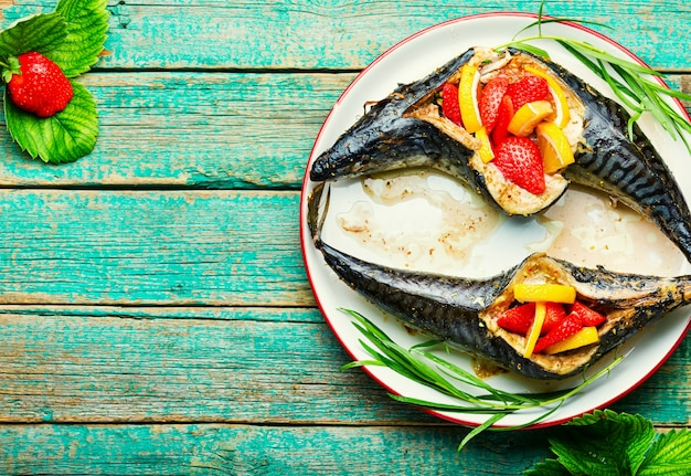 Fish roasted with berries and lemon.summer fish dish,baked mackerel.copy space