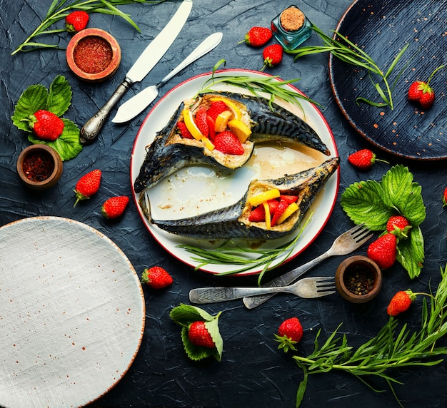 Fish roasted with berries and lemon.summer fish dish,baked mackerel.healthy eating