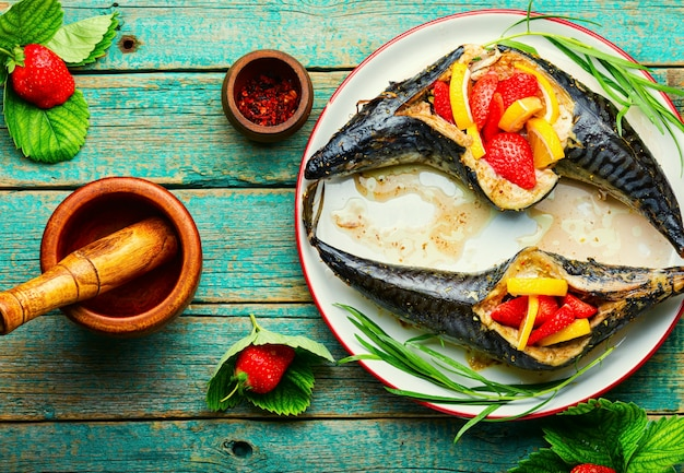 Fish roasted with strawberry and lemon.summer fish dish,baked mackerel.
