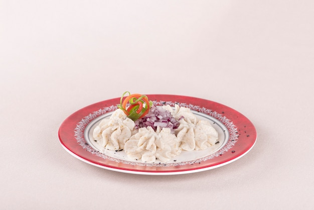 Fish roe salad, whit red onion, decorated with green and red leafs