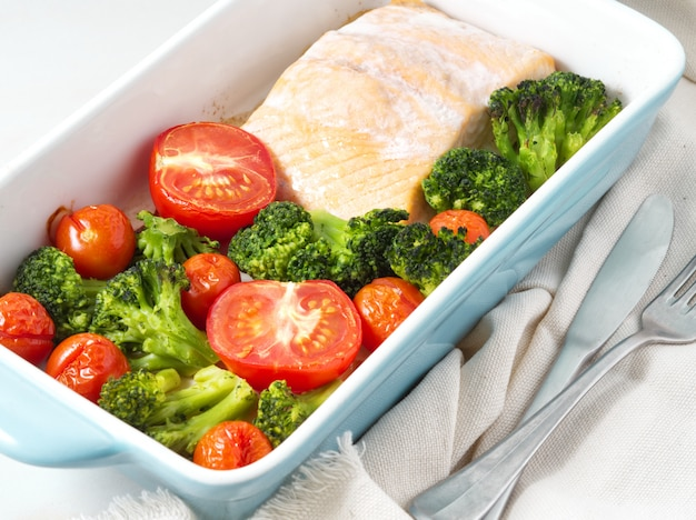 Fish salmon baked in oven with vegetables, broccoli. keto, paleo, fodmap diet