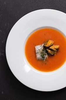 Fish soup in white plate