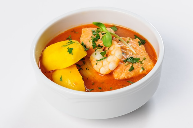 Fish soup with salmon, shrimps and potato