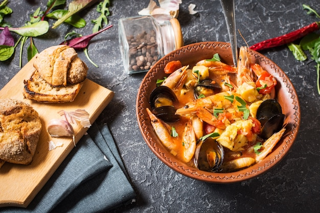 Fish soup with seafood salmon fillet shrimp mussels