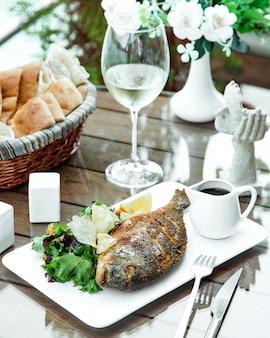 Fish with herbs lemon slice and narsharab