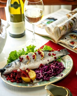 Fish with lemon and pomegranate