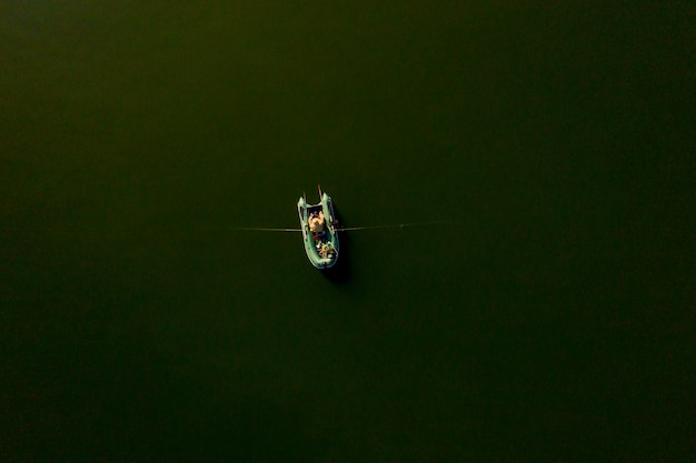 Fisherman on board a fishing boat at sunset, fisherman life style.