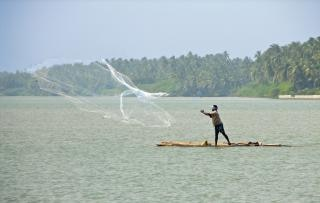 Fisherman cast net