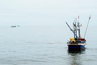 Fisherman in Small Boat in the Sea