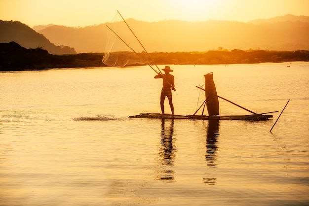 Fisherman of mekong river in action when fishing, thailand