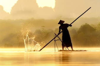 Fisherman use bamboo hit on the water surface