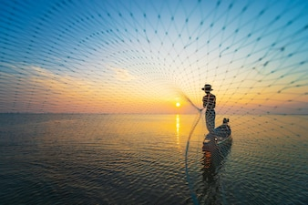 Fisherman use net catch the fish in the sea