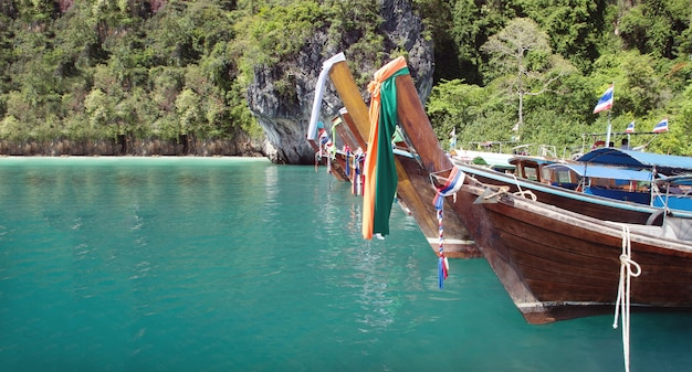 Fisherman wood boat and clean sea in thailand with travel landscape in thailand