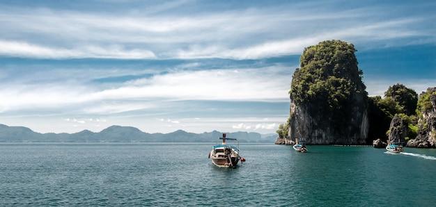 Fisherman wooden boat on green ocean