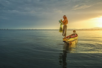 Fishermen are using fishing tools in the morning along the Songkhla Lake.