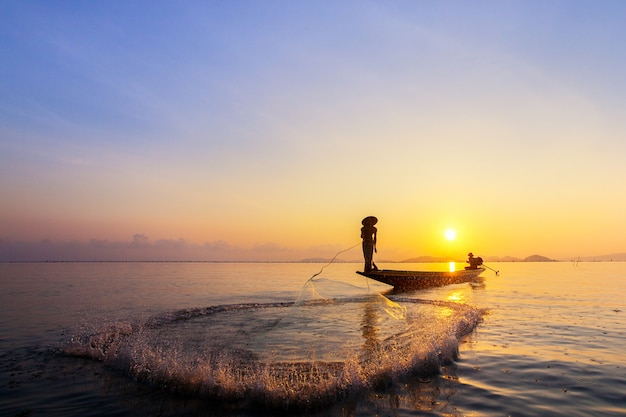 Fishermen catch fish in the morning.