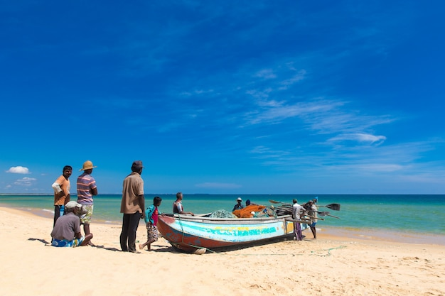 Fishermen pull a fishing net from indian ocean