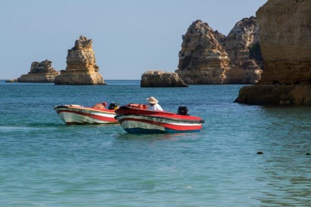 Fishermen in red boats