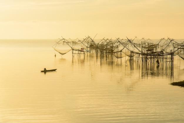 Fishermen thai style fishing trap in pak pra village