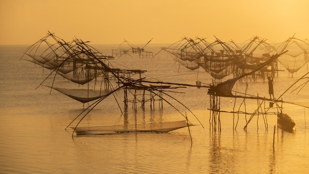 Fishermen use fishing net trap catch fish in the morning