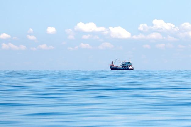 Fishing boat alone in the sea