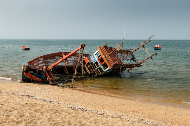 Fishing boat crashed lies on its side