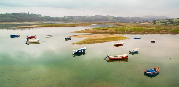 Fishing boat in the estuary of san vicente de la barquera. between asturias and cantabria. spain. panoramic photography on the coastline