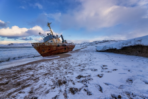 A fishing boat lying on its side, the barents sea, the kola peninsula, teriberka, russia