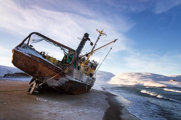 A fishing boat lying on its side, teriberka, russia