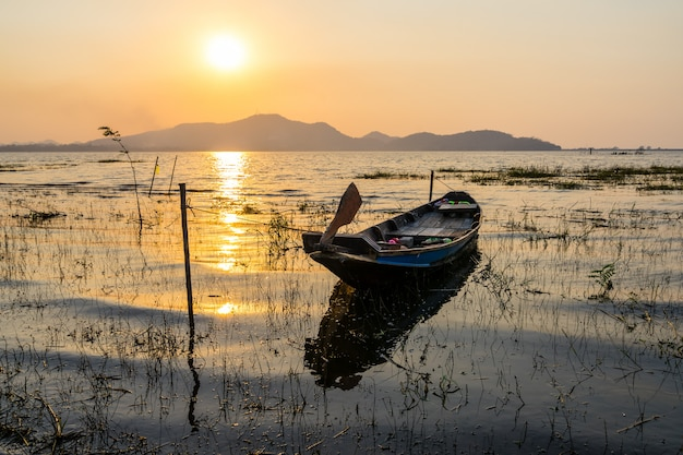 Fishing boat with sunset at bang phra reservoir