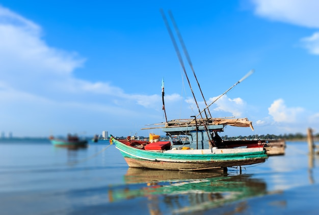 Fishing boats anchored near the shore at chonburi province