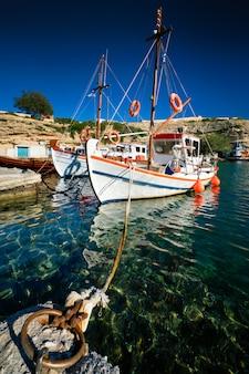 Fishing boats in harbour in fishing village of mandrakia, milos island, greece