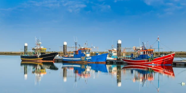 Fishing boats moored at the dock. industrial ships.