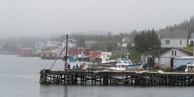 Fishing boats moored at dock, louisbourg, cape breton island, nova scotia, canada