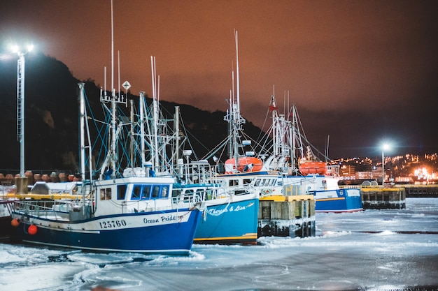 Fishing boats on sea during nighttime