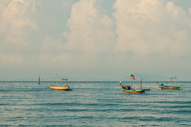 Fishing boats on the sea with blue sky  background.