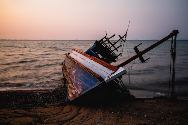 A fishing boats stranded on the beach