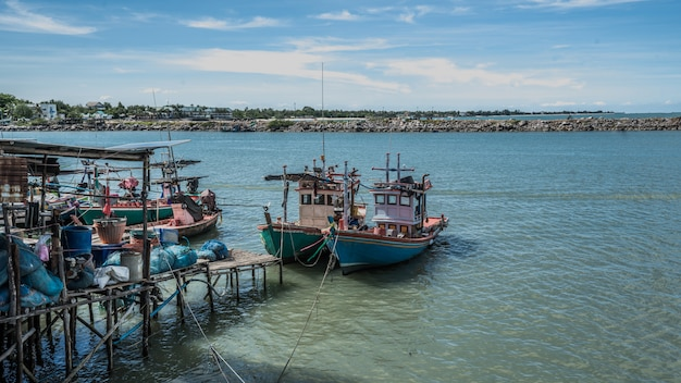 Fishing boats with sea wharf