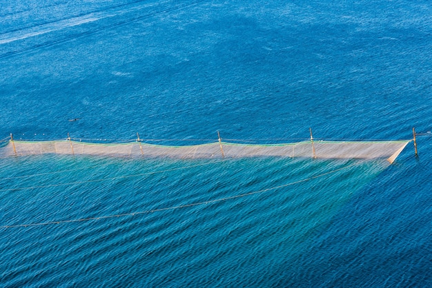 Fishing net,sea, rocks. russia, republic of crimea, cape big atlesh.