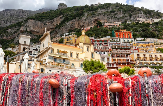 Fishing nets on the beach of positano, view of dome.