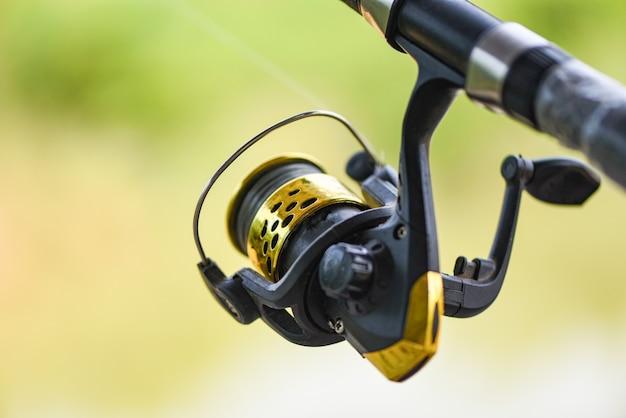 Fishing reel on fishing rod closeup
