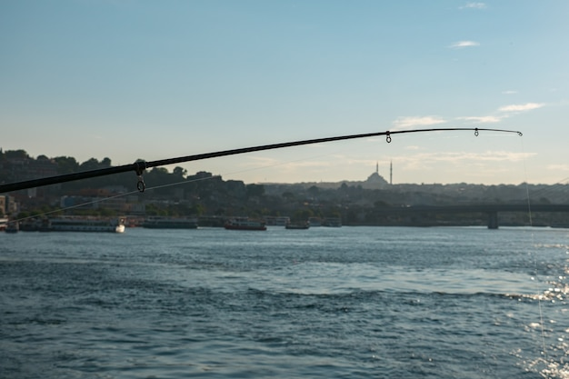 Fishing rod on the background of evening istanbul.