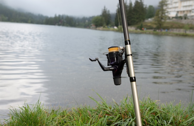 Fishing rod in front of a lake
