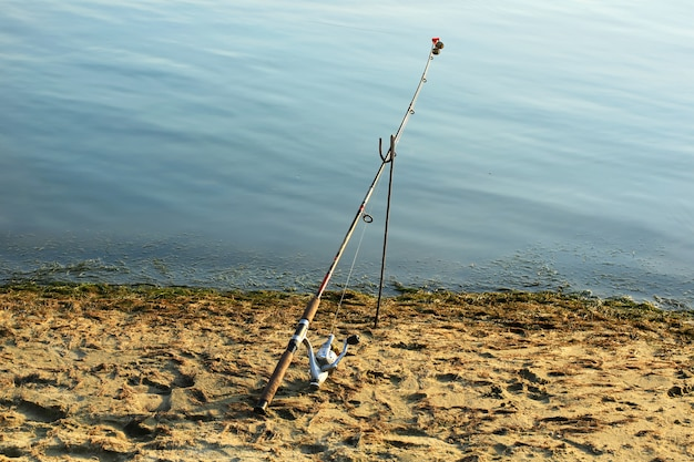 Fishing rod on the river retro old summer