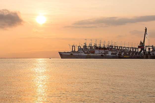 The fishing ships on a decline on a pier on kamchatka