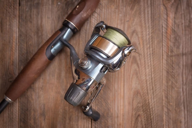 Fishing tackle on wooden background. accesories for fishing with copyspace.