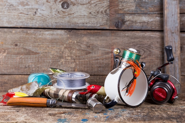 Fishing tackles, baits, line with flask, knife and white metal cup
