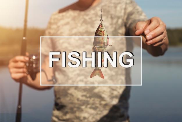 Fishing word on photo with fisherman closeup