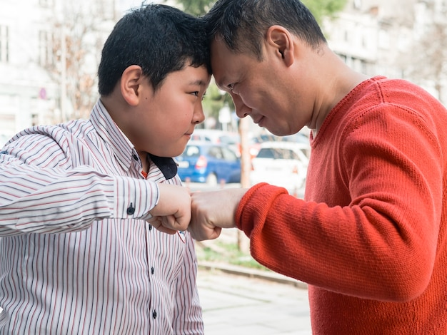 Fist bump asian father and son