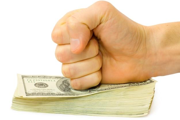 Кулак со стопкой денег, изолированные на белом фоне